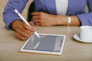 kursus seo terbaik di Serpong - Close Up of Woman Using Digital Tablet